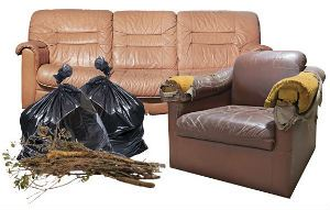 bulk trash example with couch chair two bags of trash and a bundle of limbs