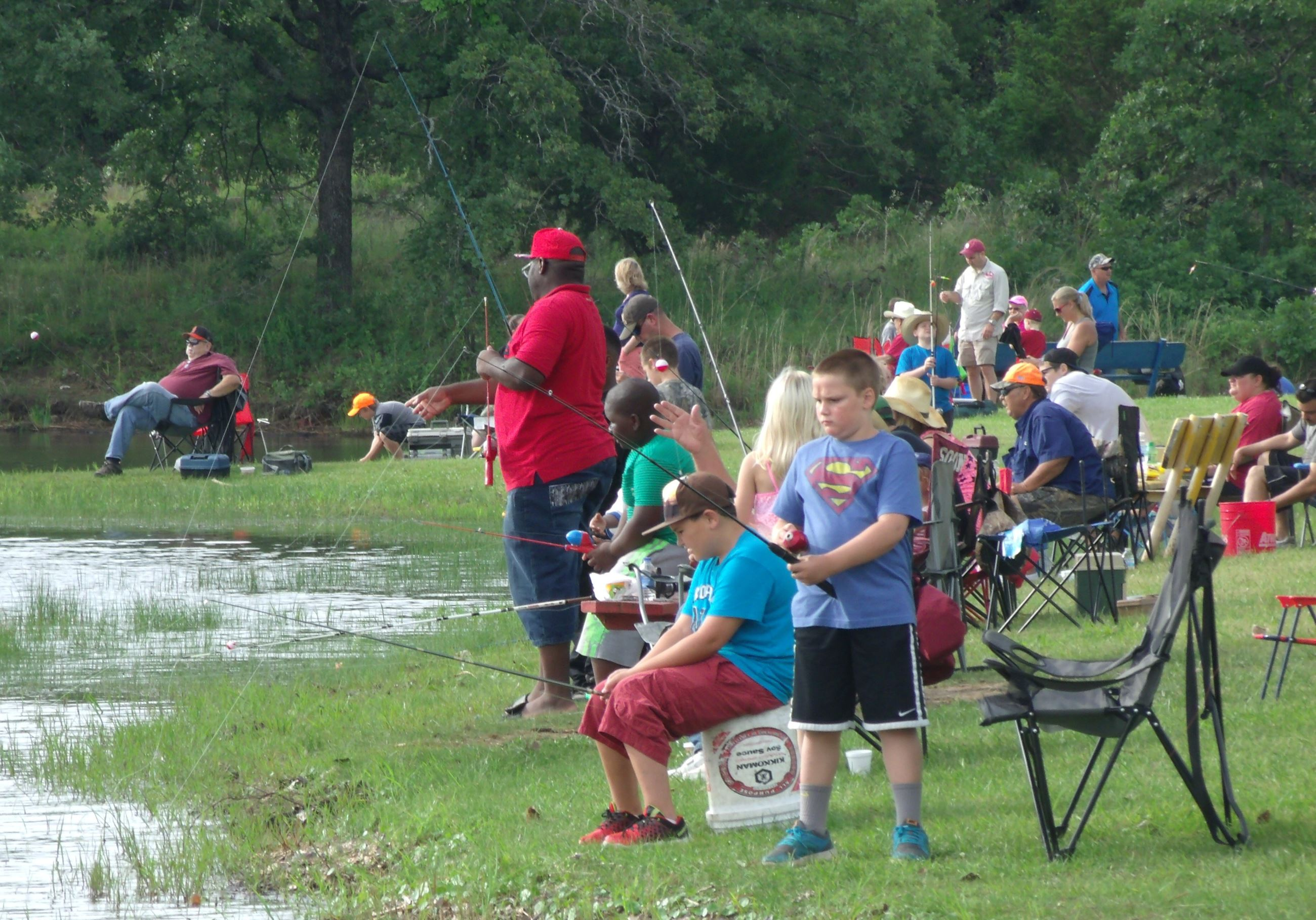 A boy and crowd fishing